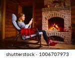 cozy home. pretty young woman... | Shutterstock . vector #1006707973