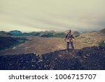 lady hiker with backpack... | Shutterstock . vector #1006715707