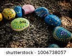 rock painted green with polka... | Shutterstock . vector #1006738057