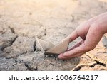 hand holding paper boat on... | Shutterstock . vector #1006764217
