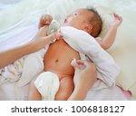 mother applying vanishing cream ... | Shutterstock . vector #1006818127