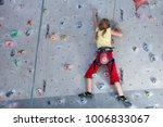 little girl climbing a rock... | Shutterstock . vector #1006833067