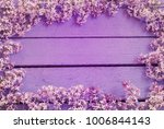 lilac flowers on wooden... | Shutterstock . vector #1006844143