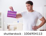 young man with gift bag at home ... | Shutterstock . vector #1006904113