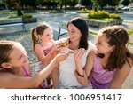 children offering their pizza... | Shutterstock . vector #1006951417