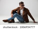 fashion man lying down and... | Shutterstock . vector #1006954777