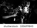 Hands of a worker repairing car motor - stock photo