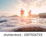 surfers couple running with... | Shutterstock . vector #1007026723