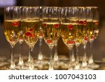 champagne in glasses served for ... | Shutterstock . vector #1007043103