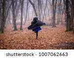 girl in black hood running away ...   Shutterstock . vector #1007062663