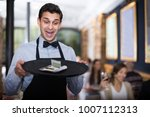 professional waiter holding... | Shutterstock . vector #1007112313