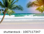 the beach with white sand and... | Shutterstock . vector #1007117347