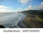 piha beach with rock formations ... | Shutterstock . vector #1007143453