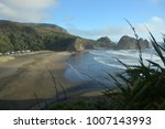 piha beach with rock formations ... | Shutterstock . vector #1007143993