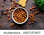 dry dog food in bowl on wooden... | Shutterstock . vector #1007157607