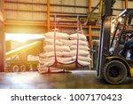 forklift handling white sugar...   Shutterstock . vector #1007170423