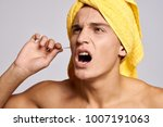 man cleans his ears on a light ... | Shutterstock . vector #1007191063