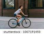 young beautiful girl rides her... | Shutterstock . vector #1007191453