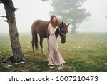 young woman with a horse ... | Shutterstock . vector #1007210473