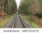 railroad tracks lead through... | Shutterstock . vector #1007221273
