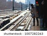 passengers waiting train in... | Shutterstock . vector #1007282263