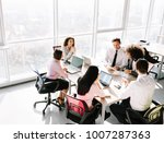 teamwork in boardroom. team... | Shutterstock . vector #1007287363