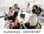 business team sitting at round... | Shutterstock . vector #1007287387