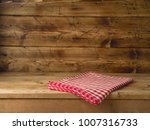 empty wooden table with red... | Shutterstock . vector #1007316733