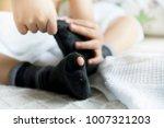 children hands pulling his... | Shutterstock . vector #1007321203