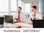 two representative coworkers in ... | Shutterstock . vector #1007328427