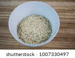oatmeal in a white cup  wooden... | Shutterstock . vector #1007330497