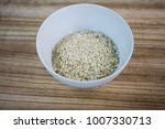 oatmeal in a white cup  wooden... | Shutterstock . vector #1007330713