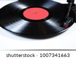 black vinyl record disc with... | Shutterstock . vector #1007341663