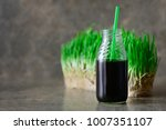 freshly squized wheatgrass... | Shutterstock . vector #1007351107