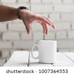 man's hand is going to take a... | Shutterstock . vector #1007364553