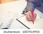 business man hand holding a pen ... | Shutterstock . vector #1007414953