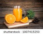orange juice with slices fresh... | Shutterstock . vector #1007415253
