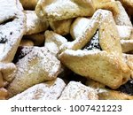 Small photo of hamantaschen close up Purim traditional food symbol Jewish holiday adar triangular cookie