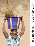 african girl holding sink on... | Shutterstock . vector #1007424277