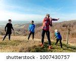 family jogging for sport... | Shutterstock . vector #1007430757