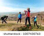 family jogging for sport... | Shutterstock . vector #1007430763