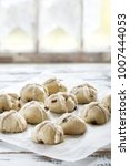 raw unbaked buns. ready to bake ... | Shutterstock . vector #1007444053