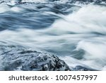 a powerful stream of mountain... | Shutterstock . vector #1007457997