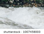 a powerful stream of mountain... | Shutterstock . vector #1007458003