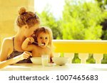 little boy eats himself sitting ... | Shutterstock . vector #1007465683