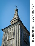 wooden tower of old church with ... | Shutterstock . vector #1007483497
