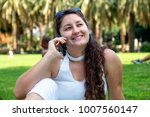 woman with phone   Shutterstock . vector #1007560147