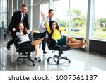 cheerful colleagues having fun... | Shutterstock . vector #1007561137
