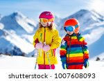 child skiing in the mountains.... | Shutterstock . vector #1007608093