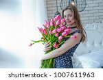 the girl holds in her hands a... | Shutterstock . vector #1007611963